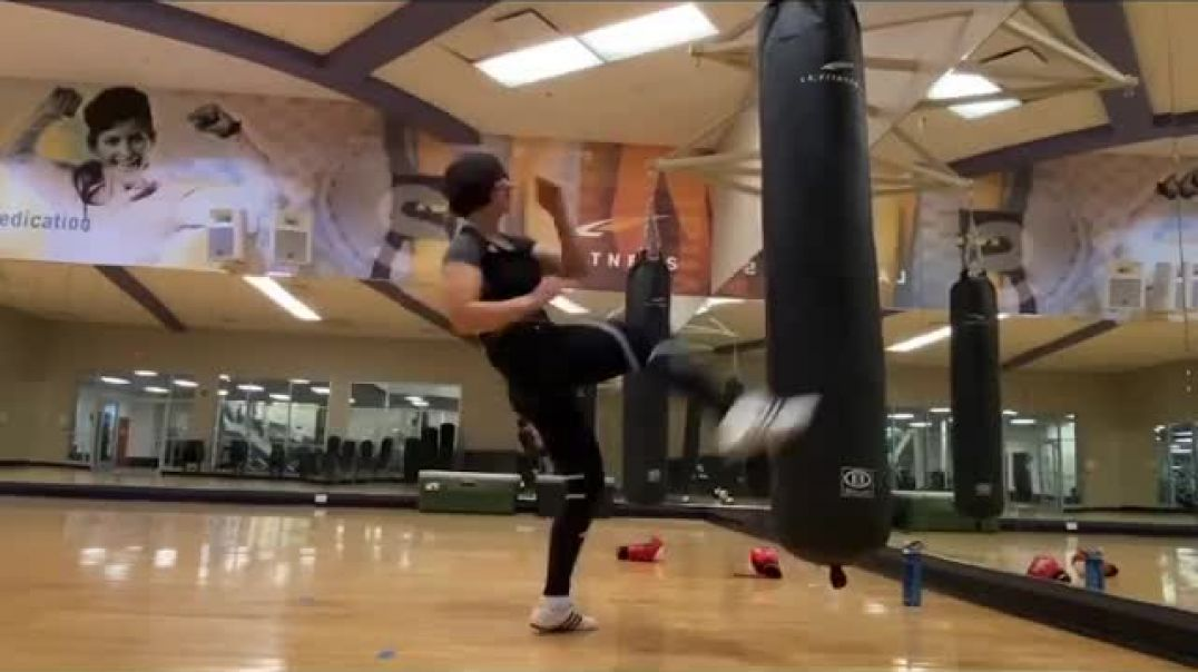 Woman kicks punchbag