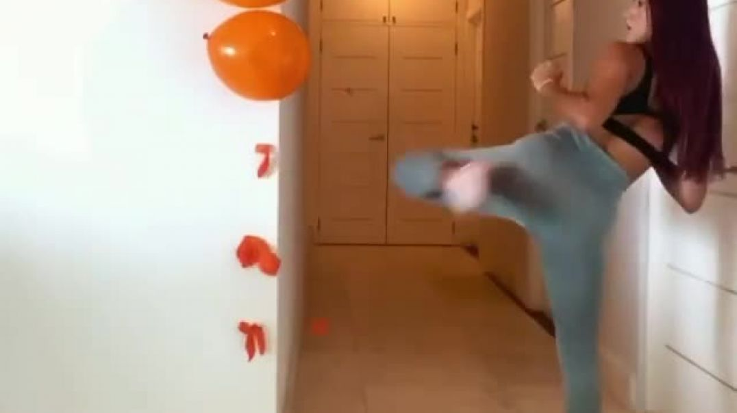 Girl pops balloons with kickc